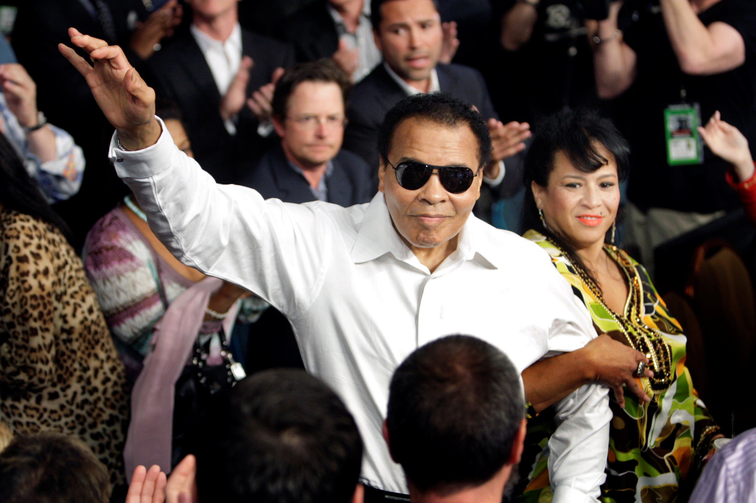 File photo of boxing legend Ali standing with his wife Yolanda as he is introduced at the MGM Grand Garden Arena in Las Vegas. (Reuters)