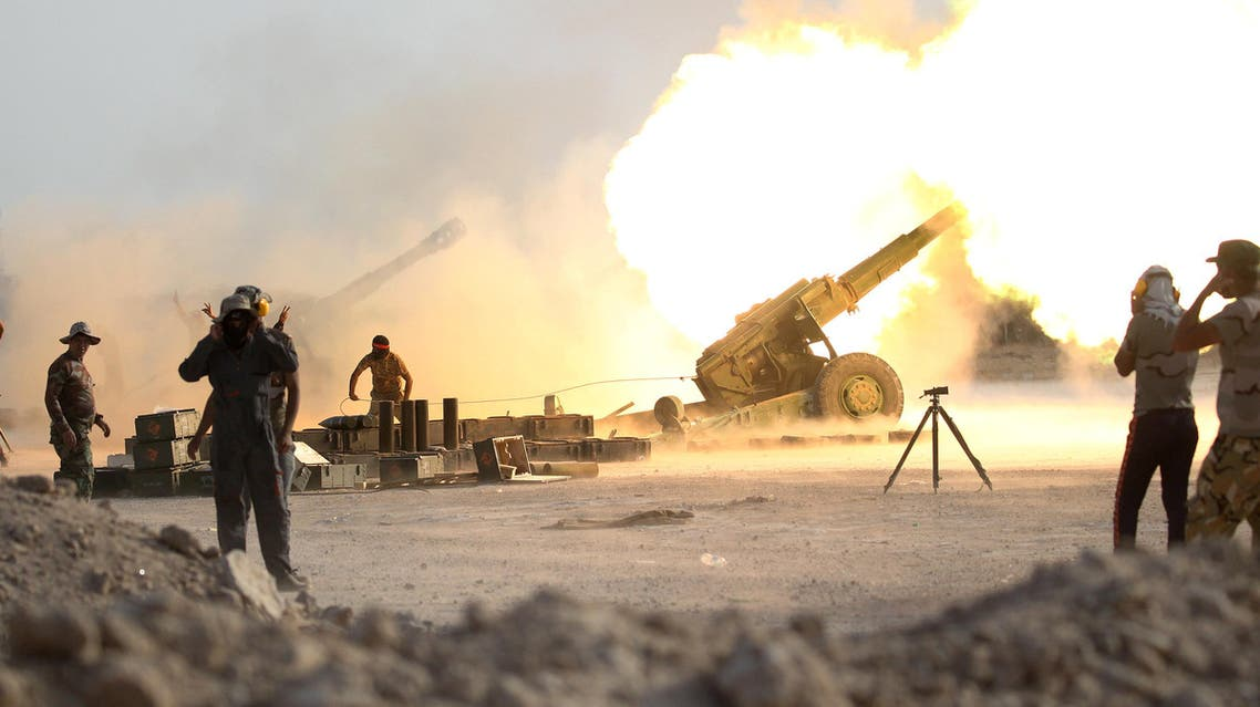 Iraqi security forces and Shiite fighters fire artillery towards ISIS militants near Fallujah. (Reuters)