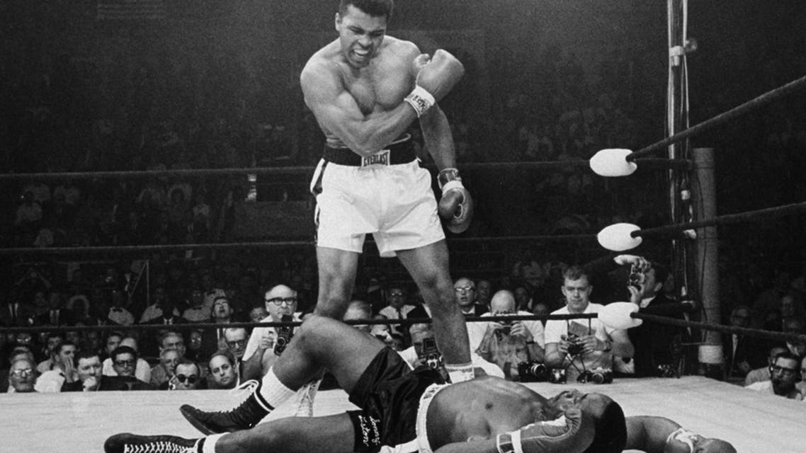 Heavyweight champion Muhammad Ali stands over fallen challenger Sonny Liston, shouting and gesturing shortly after dropping Liston with a short hard right to the jaw on May 25, 1965, in Lewiston, Maine. (AP)