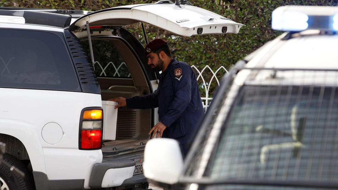 Police inspect cars at a checkpoint, during a manhunt for prisoners that escaped from Muharraq jail, in Manama, Bahrain, June 4, 2016. REUTERS