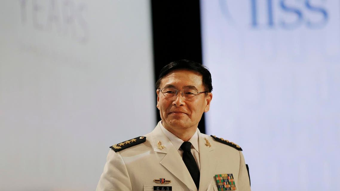 China's Deputy Chief, Joint Staff Department, Central Military Commission, Adm. Sun Jianguo arrives for a plenary session at the 15th International Institute for Strategic Studies Shangri-la Dialogue, or IISS, Asia Security Summit on Sunday, June 5, 2016, in Singapore. (AP)