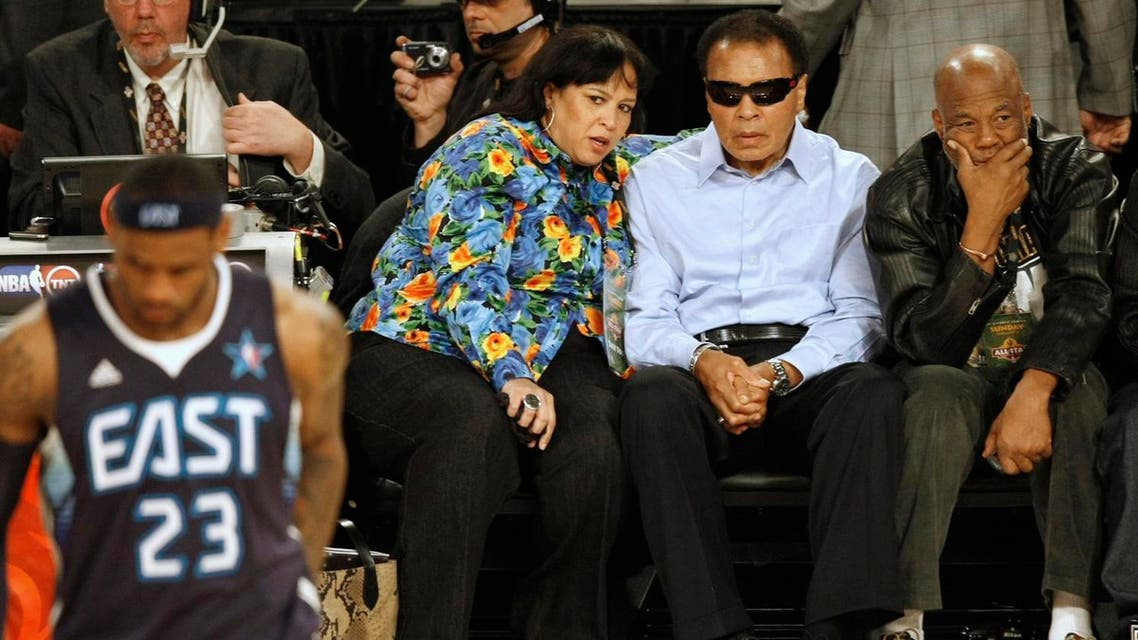 Muhammad Ali (2nd R) watches during the first quarter of the NBA All-Star basketball game in Phoenix, Arizona, February 15, 2009. REUTERS