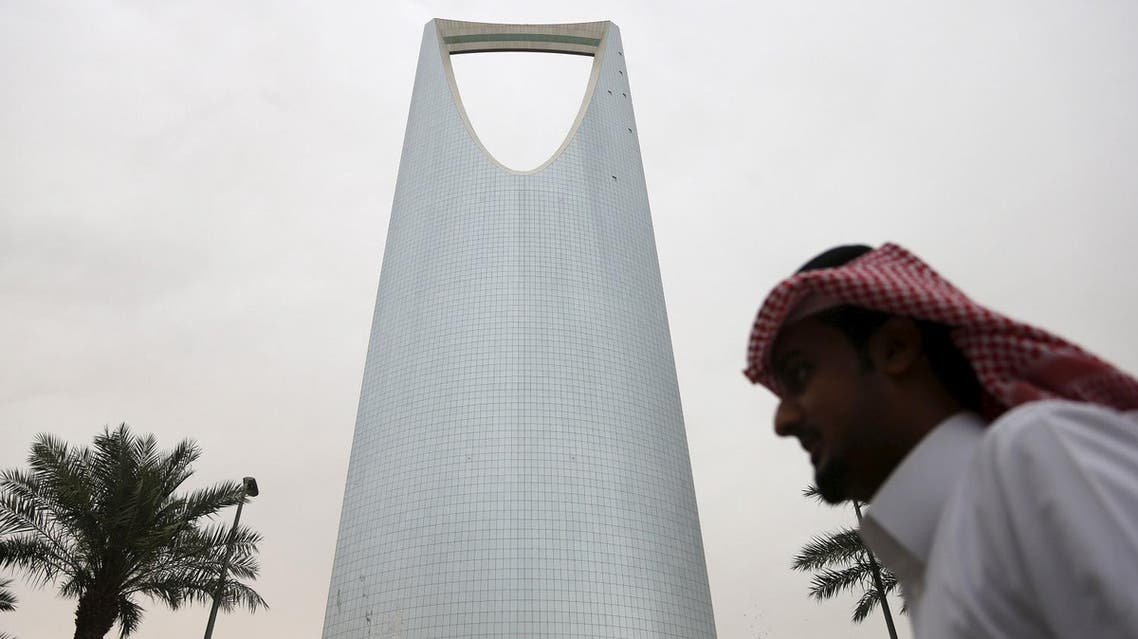 A man walks past the Kingdom Centre Tower in Riyadh, Saudi Arabia April 12, 2016. To match Insight SAUDI-ECONOMY/PLAN Picture taken April 12, 2016. REUTERS