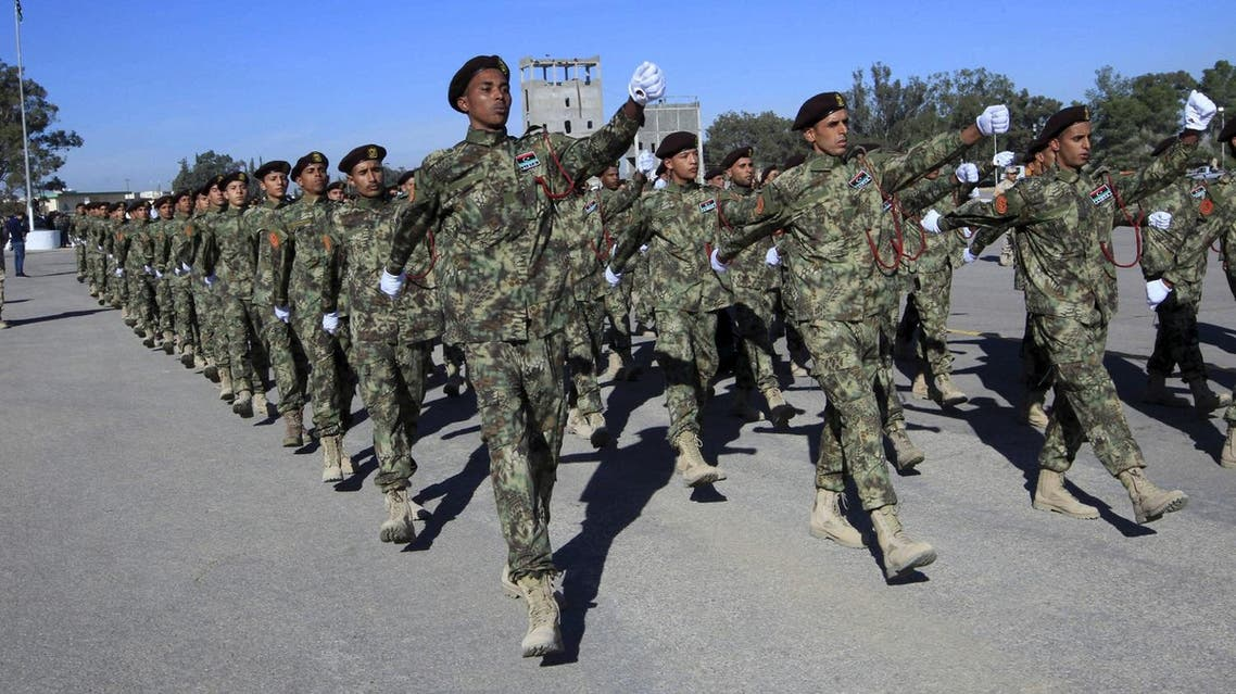 Libyan Army soldiers march during a military graduation parade in Tripoli December 24, 2015. REUTERS