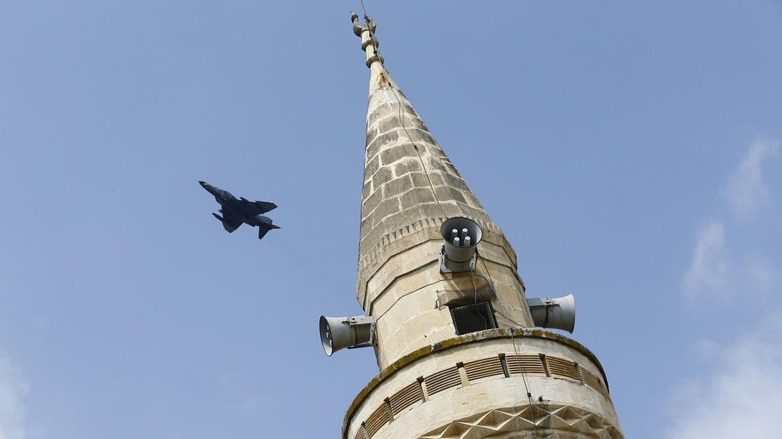 A Turkish Air Force F-4E fighter flies over a minaret after taking off from Incirlik air base in Adana, Turkey, August 12, 2015. REUTERS