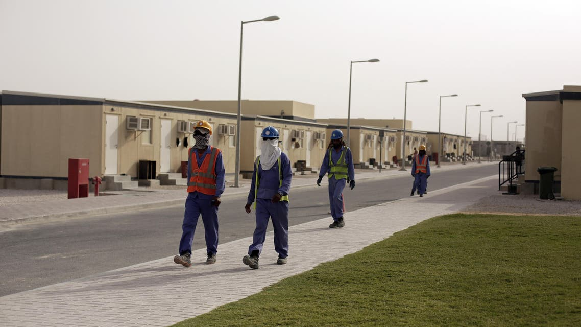 In this Sunday, May 3, 2015 photo taken during a government organized media tour, laborers head back to their housing at the end of their workday, in Doha, Qatar. (AP)