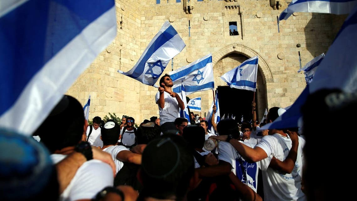 Israelis carry flags during a march marking Jerusalem Day, the anniversary of Israel's capture of East Jerusalem during the 1967 Middle East war, just outside Damascus Gate of Jerusalem's Old City June 5, 2016. REUTERS