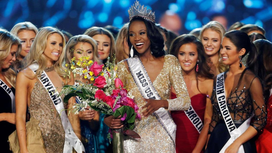Deshauna Barber (C) of the District of Columbia celebrates with other contestants after being crowned Miss USA 2016 during the 2016 Miss USA pageant at the T-Mobile Arena in Las Vegas, Nevada, U.S., June 5, 2016. REUTERS