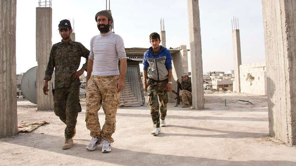 Abu Layla (Centre), who commanded a brigade inside the predominantly-Kurdish Syrian Democratic Forces, was hit by ISIS sniper fire. (AP)