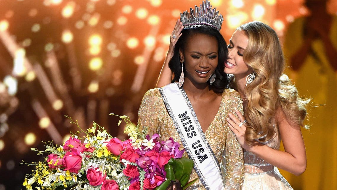 LAS VEGAS, NV - JUNE 05: Miss District of Columbia USA 2016 Deshauna Barber reacts as she is crowned Miss USA 2016 by Miss USA 2015 Olivia Jordan during the 2016 Miss USA pageant at T-Mobile Arena on June 5, 2016 in Las Vegas