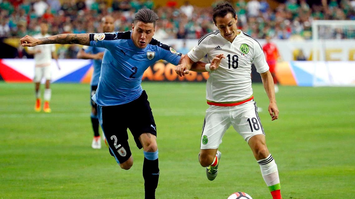 Mexico midfielder Andres Guardado (18) and Uruguay defender Jose Gimenez (2) during the second half of a Copa America group C soccer match at University of Phoenix Stadium, Sunday, June 5, 2016, in Glendale, Ariz. (AP)