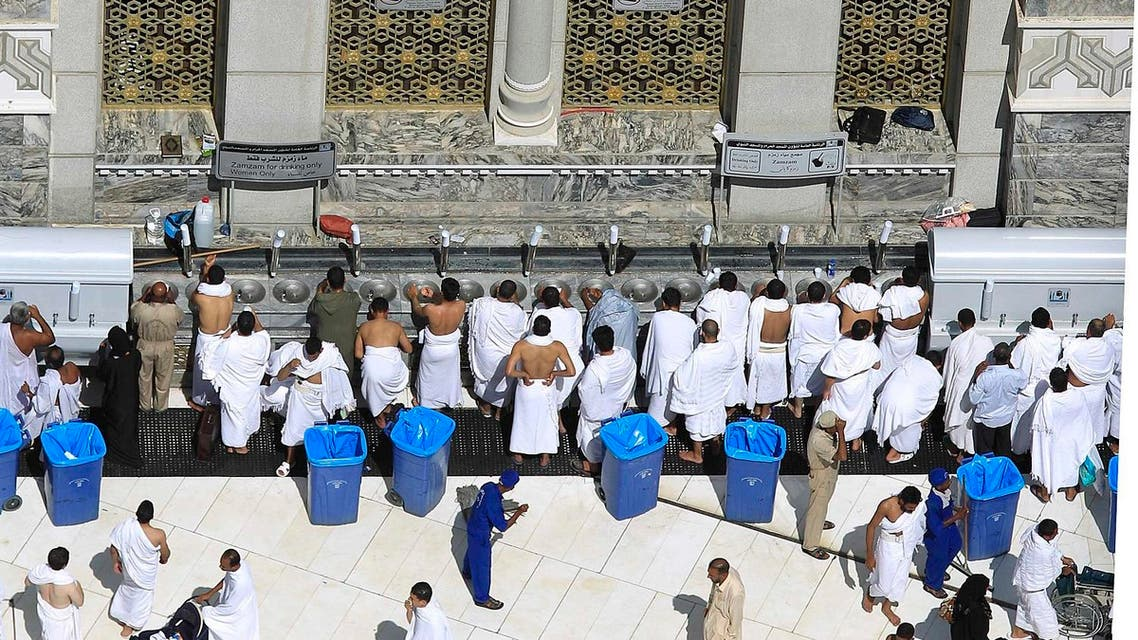 Muslim pilgrims drink Zamzam water before the Friday prayer inside the Grand Mosque, in Mecca, Saudi Arabia, Friday, Nov. 4, 2011. The annual Islamic pilgrimage draws three million visitors each year, making it the largest yearly gathering of people in the world. The Hajj will begin on November 5. (AP)