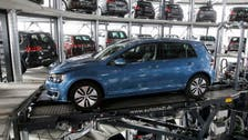 Germany talks tough on auto emissions