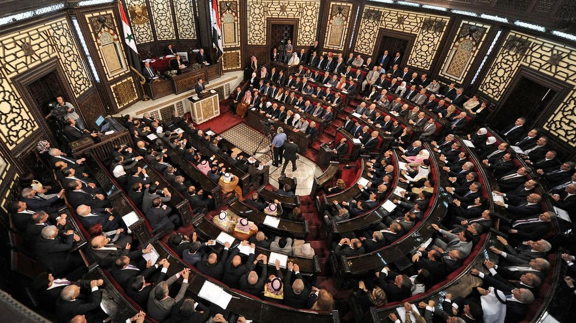 A general view shows the Syrian Parliament members listening to Syria's president Bashar al-Assad while he talks on the podium in Damascus, Syria in this handout picture provided by SANA on June 7, 2016. (SANA/Handout via Reuters)