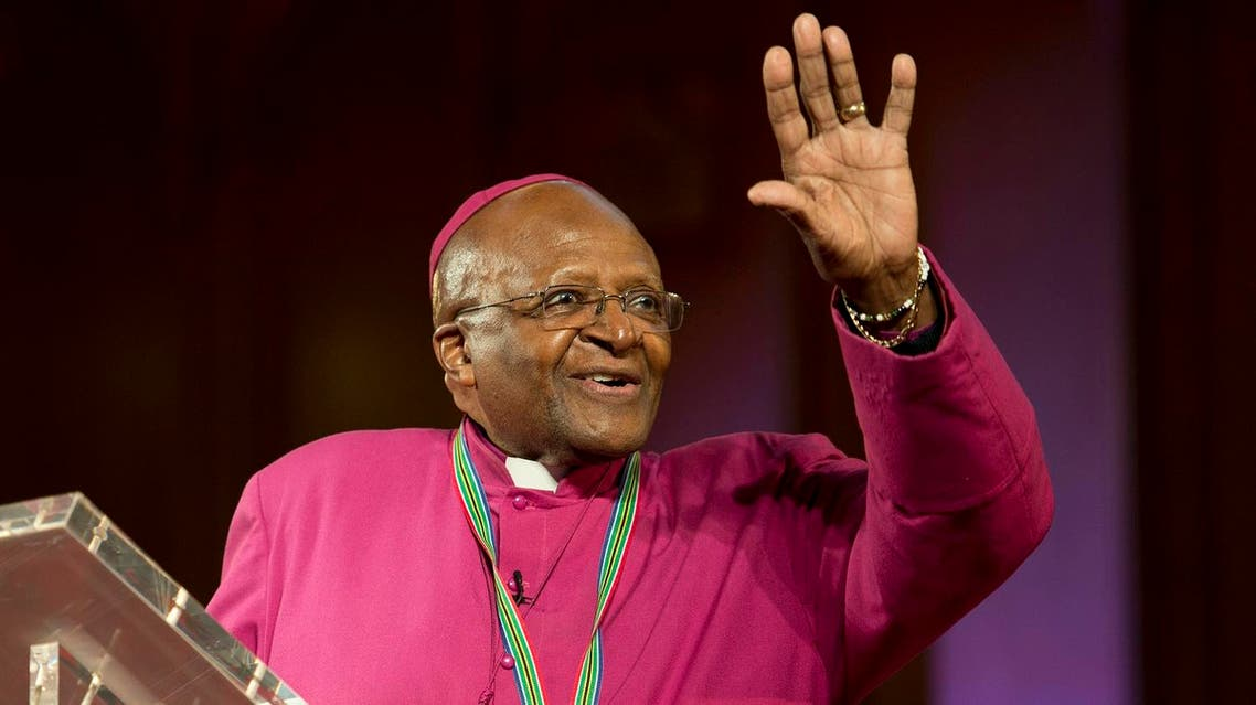 The former Anglican archbishop of Cape Town Desmond Tutu waves after receiving the 2013 Templeton Prize at the Guildhall in central London on May 21, 2013. South African anti-apartheid campaigner Desmond Tutu won the 2013 Templeton Prize worth $1.7 million for helping inspire people around the world by promoting forgiveness and justice, organisers said. REUTERS