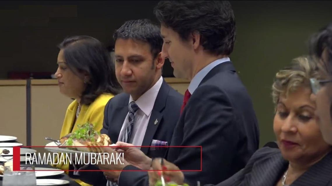 Trudeau can be seen digging into Middle Easter and Asian dishes like Hummus, stuffed vine leaves and dates. (Twitter)