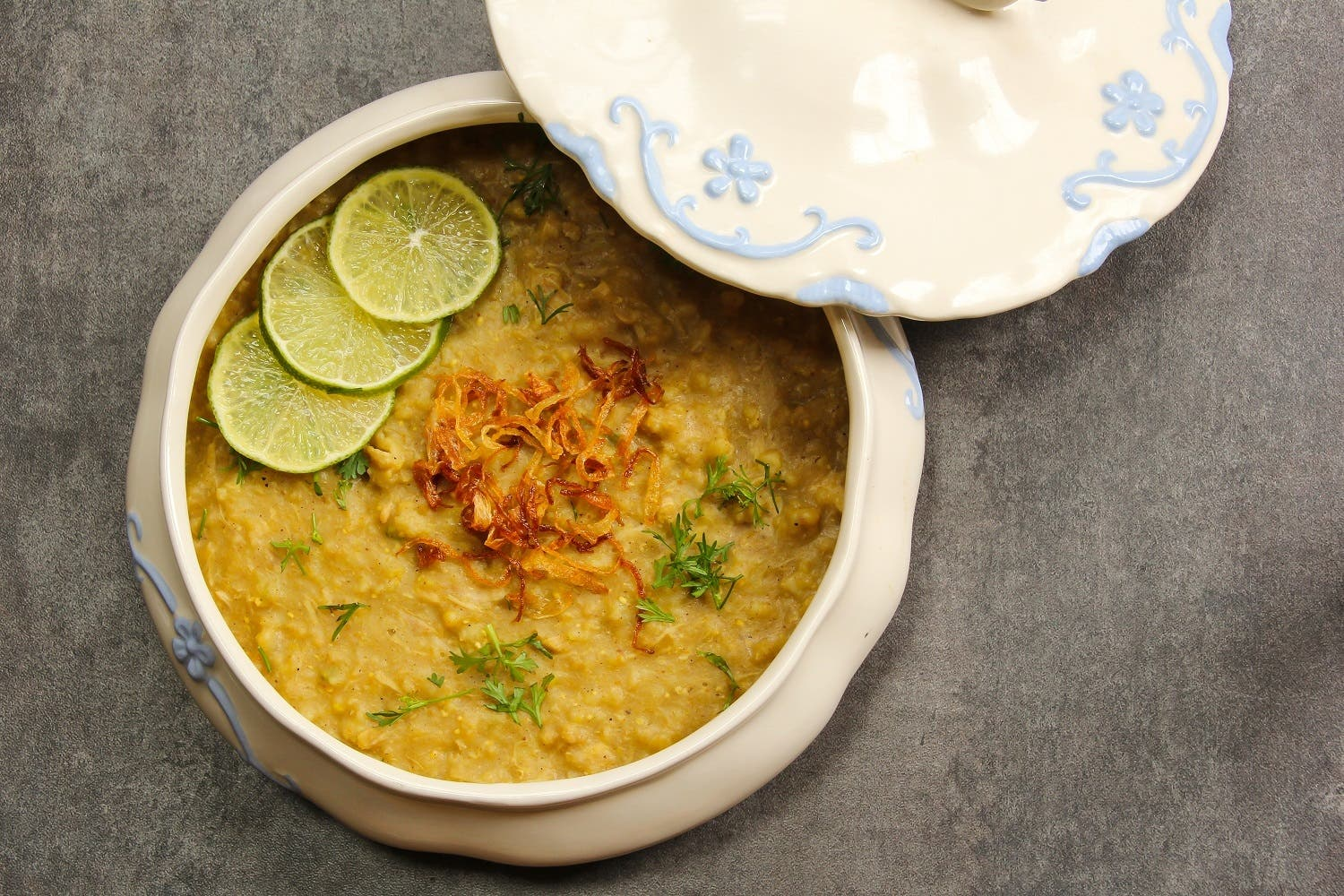 Haleem is a stew composed of meat, lentils and pounded wheat made into a thick paste. It is originally an Arabic dish and was introduced to the Hyderabad State by the Chaush people during the rule of the Nizams. (Shutterstock)