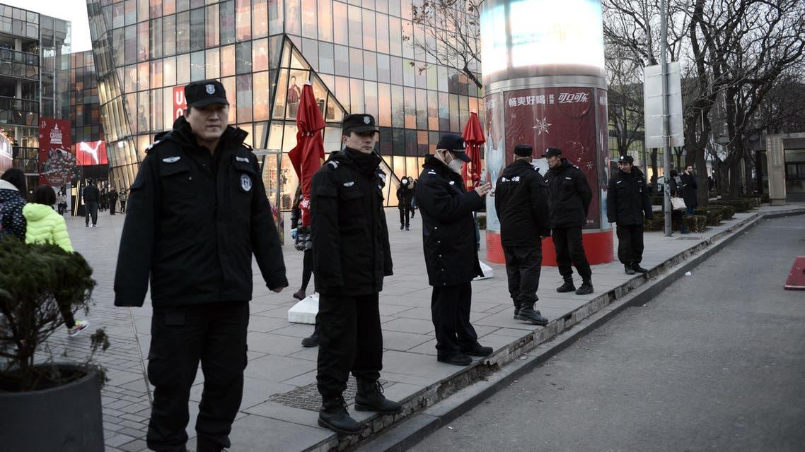 عناصر من الشرطة الصينية في بكين - فرانس برس