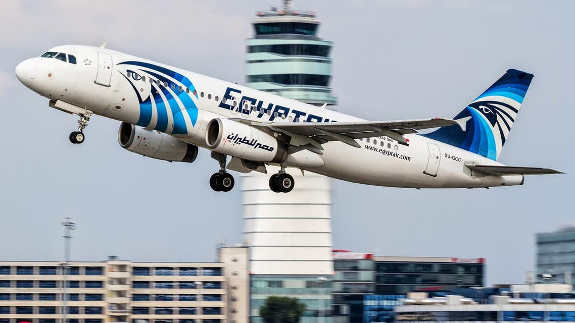 This August 21, 2015 file photo shows an EgyptAir Airbus A320 with the registration SU-GCC taking off from Vienna International Airport, Austria. Egyptians officials say a bomb threat has forced an EgyptAir airliner en route to Beijing from Cairo to make an emergency landing in Uzbekistan, where the aircraft is being searched. (AP Photo/Thomas Ranner, File)