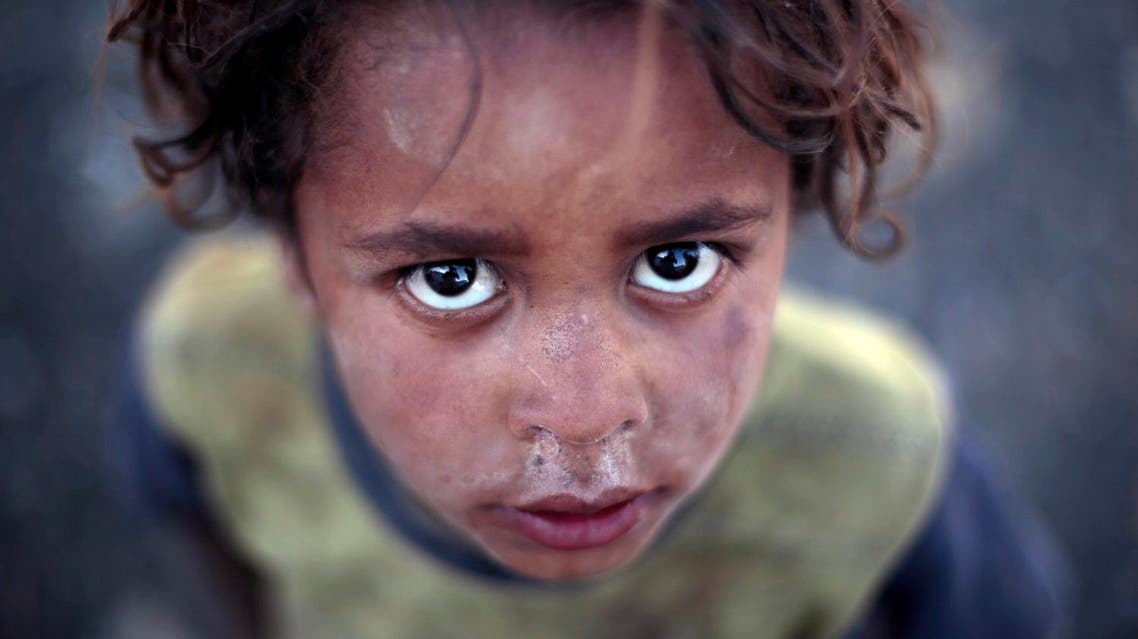 A displaced boy poses for a photo at a camp for internally displaced people in the outskirts of Sanaa, Yemen, Wednesday, June 8, 2016 (Photo: AP)