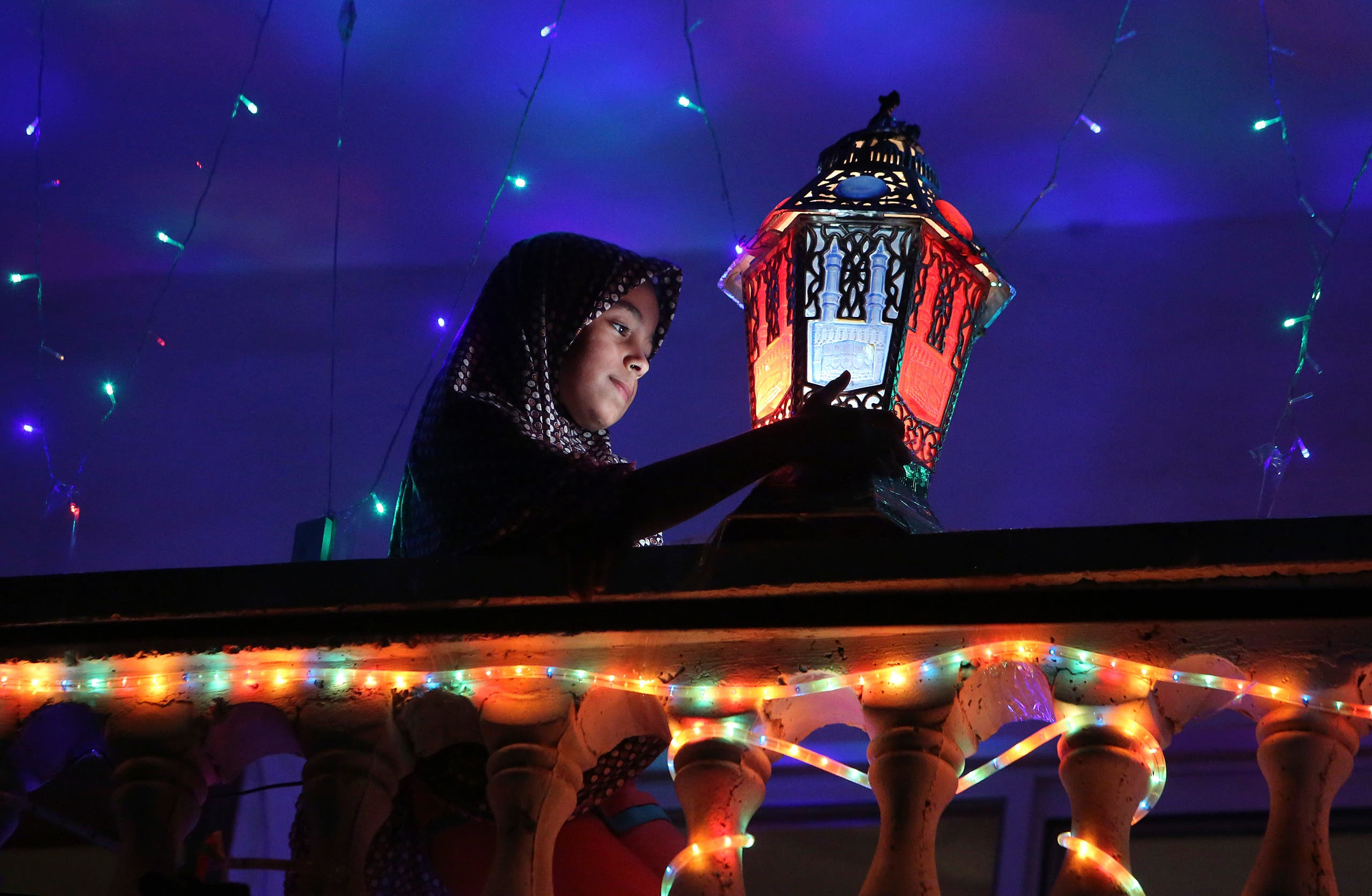 Raghad Hamami Cleans A Traditional Ramadan Lantern Placed On The Balcony Of Her Family House During Holy Month In Gaza AP
