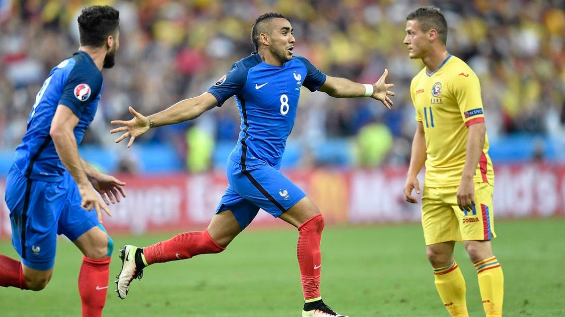 France's Dimitri Payet, center, celebrates after scoring his side's second goal during the Euro 2016 Group A soccer match between France and Romania, at the Stade de France, in Saint-Denis, north of Paris, Friday, June 10, 2016. (AP)