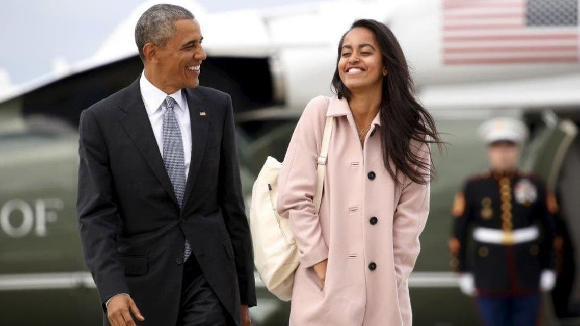 U.S. President Barack Obama and his daughter Malia walk from Marine One to board Air Force One upon their departure from O'Hare Airport in Chicago April 7, 2016. REUTERS