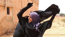 Syrian woman seen throwing off niqab after ISIS leaves village