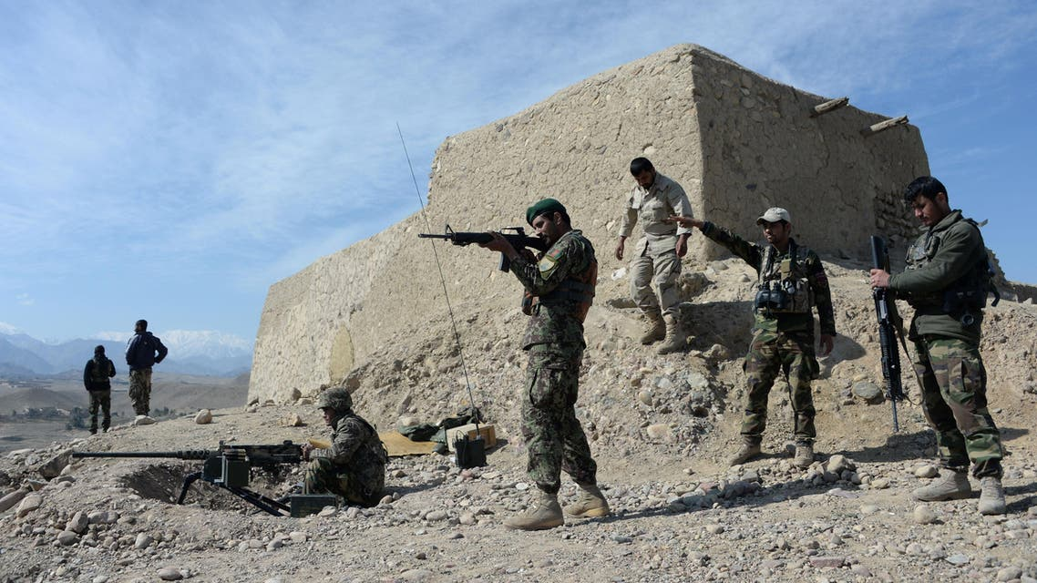 In this photograph taken on February 17, 2016, Afghan security forces patrol following an operation against Islamic State (IS) militants in Achin district in Nangarhar province. afp