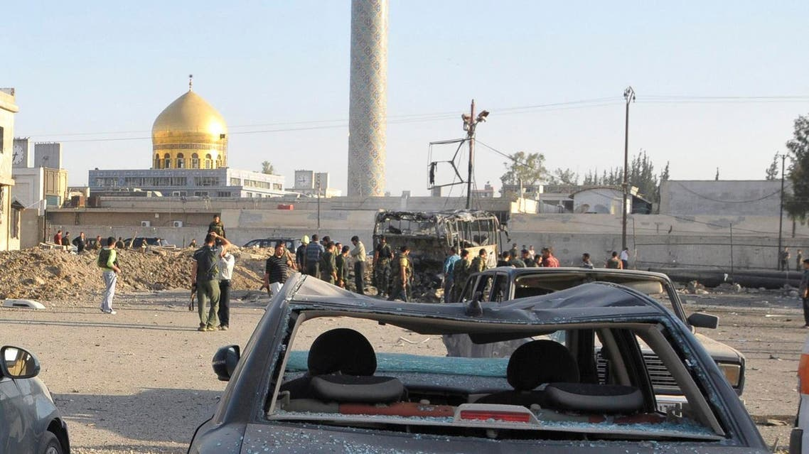 Security and residents inspect the site where a car bomb exploded in front of the gold-domed Shi'ite shrine of Sayyida Zeinab in southern Damascus, June 14, 2012. A car bomb exploded in a car park in southern Damascus, near the gold-domed Shi'ite shrine of Sayyida Zeinab, activists and state media said.The powerful blast caused a deep crater in the tarmac and wrecked several buses, smashing windows of cars across a wide area. Two people were wounded, state news agency SANA reported. REUTERS