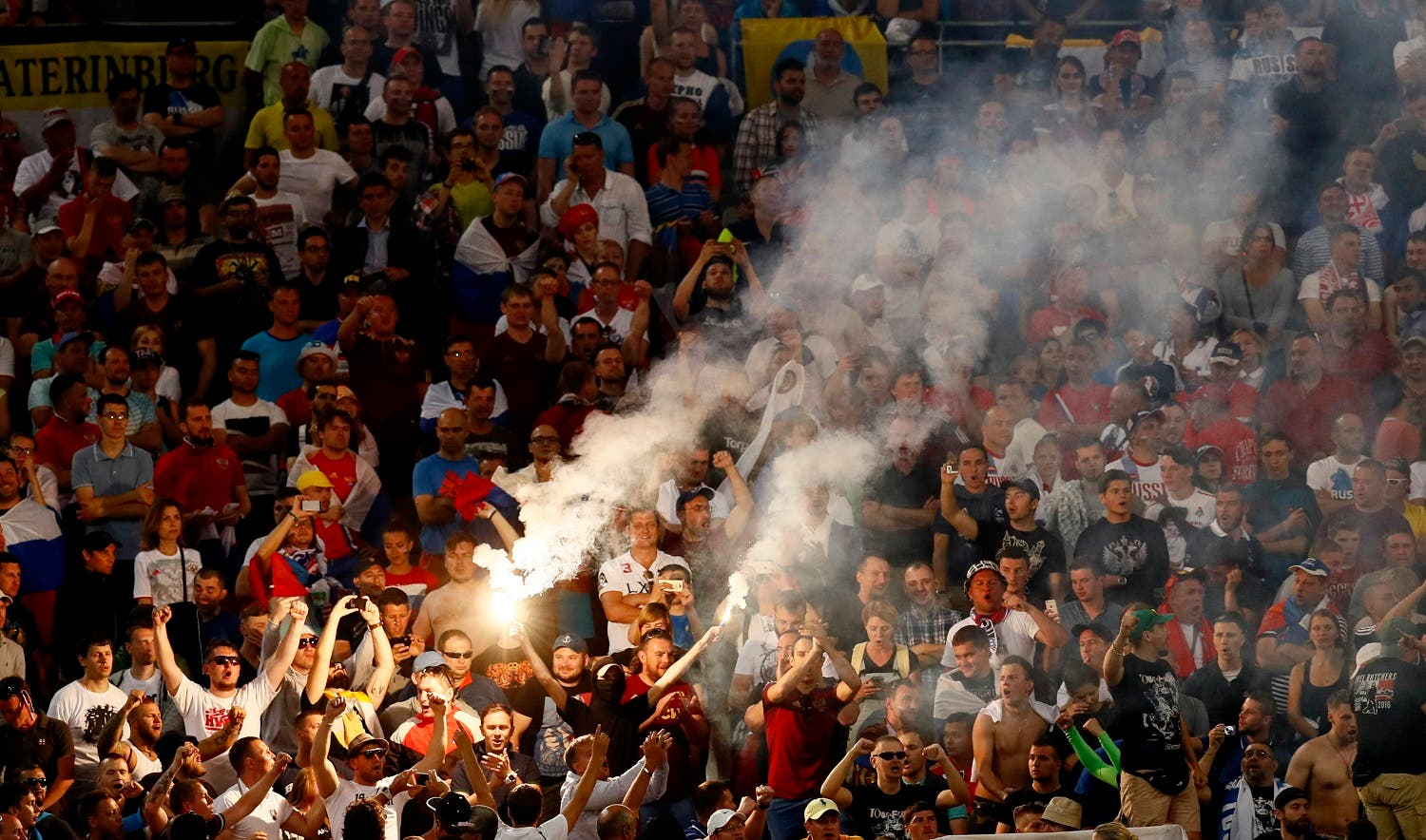 Football Soccer - England v Russia - EURO 2016 - Group B - Stade V?lodrome, Marseille, France - 11/6/16 Russia fans let off a flare REUTERS/Jason Cairnduff
