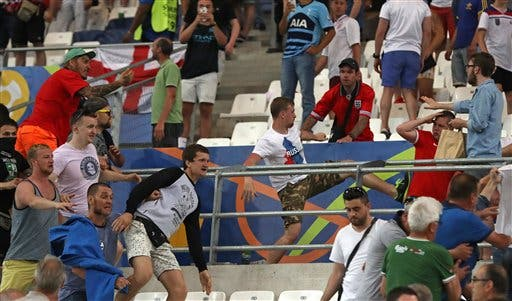 Russian supporters attack England fans at the end of the Euro 2016 Group B soccer match between England and Russia, at the Velodrome stadium in Marseille, France, Saturday, June 11, 2016. (AP