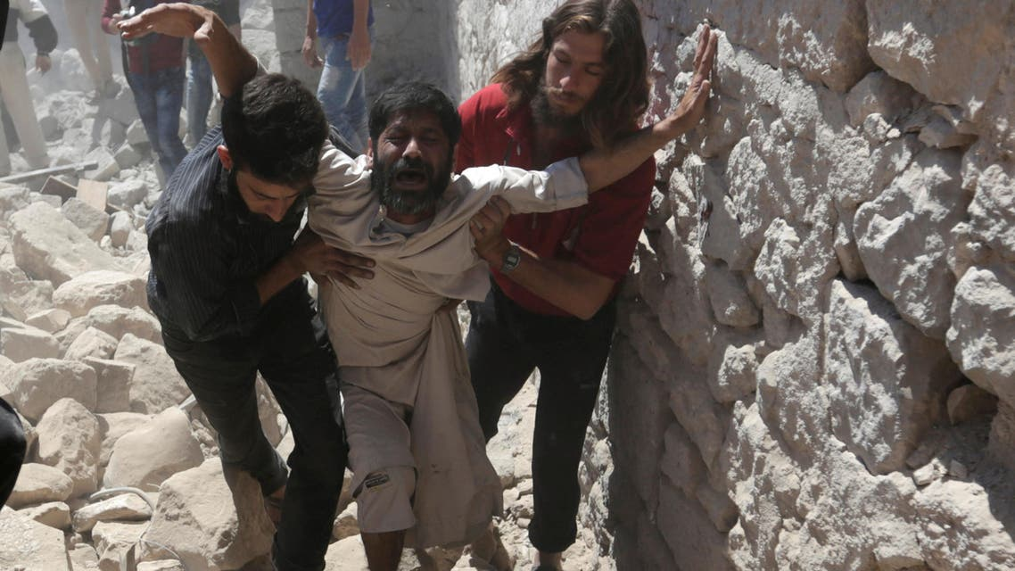 A man whose son was killed reacts at a site hit by airstrike in the rebel-controlled area of Maaret al-Numan town in Idlib province, Syria, June 12, 2016. REUTERS