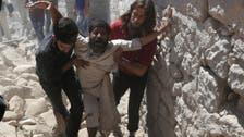 Air strikes kill 21 at market in Syria's Idlib
