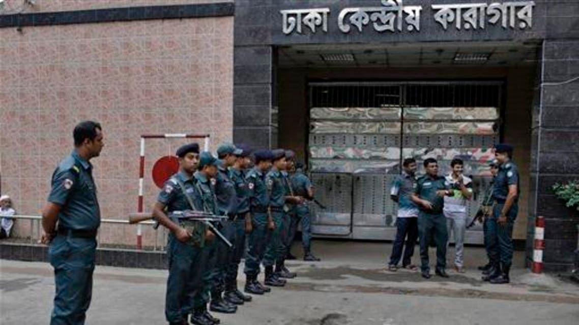 Bangladeshi policemen stand guard outside the Dhaka Central Jail in Dhaka, Bangladesh, Sunday, June 12, 2016. AP