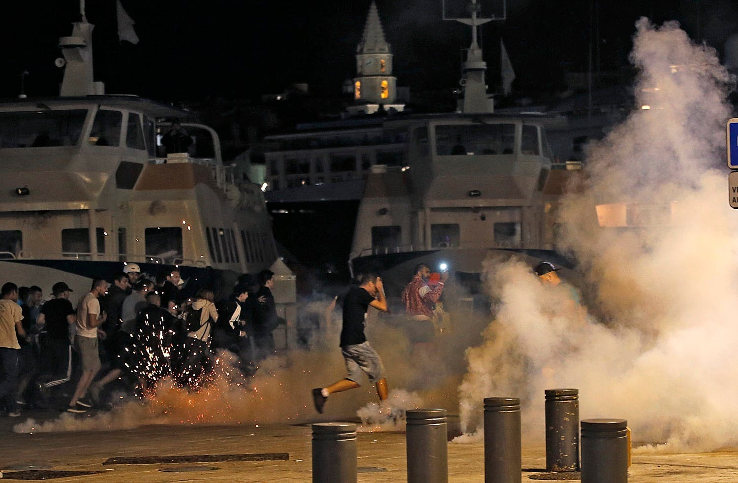 Marseille, France 11/6/16 Police disperse revellers at the old port of Marseille after the England v Russia - Group B match. REUTERS