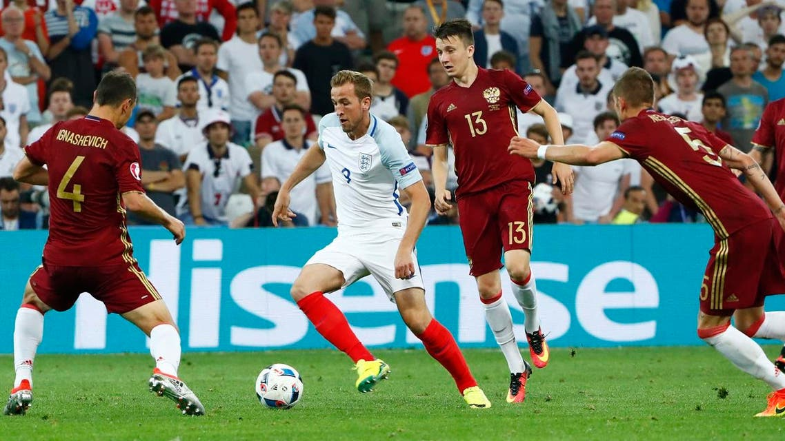 England's Harry Kane in action with Russia's Sergei Ignashevich REUTERS