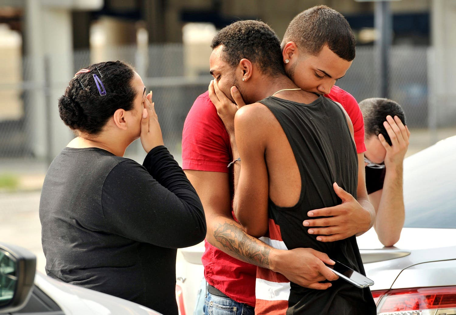 Friends and family members embrace outside the Orlando Police Headquarters during the investigation of a shooting at the Pulse night club (Photo: REUTERS)