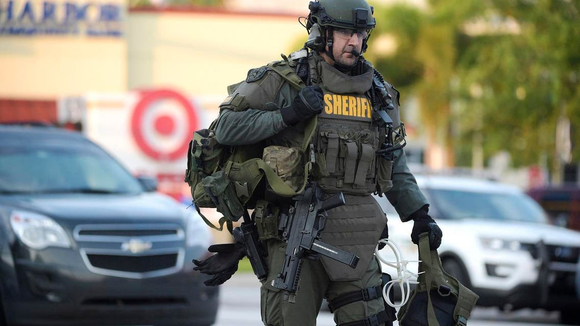 An Orange County Sheriff's Department SWAT member arrives to the scene of a fatal shooting at Pulse Orlando nightclub in Orlando, Florida, Sunday, June 12, 2016 (Photo: AP)