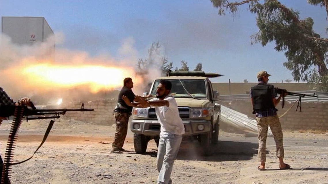 In this Saturday, July 26, 2014 file frame grab from video obtained from a freelance journalist traveling with the Misarata brigade, fighters from the Islamist Misarata brigade fire towards Tripoli airport in an attempt to wrest control from a powerful rival militia, in Tripoli, Libya AP