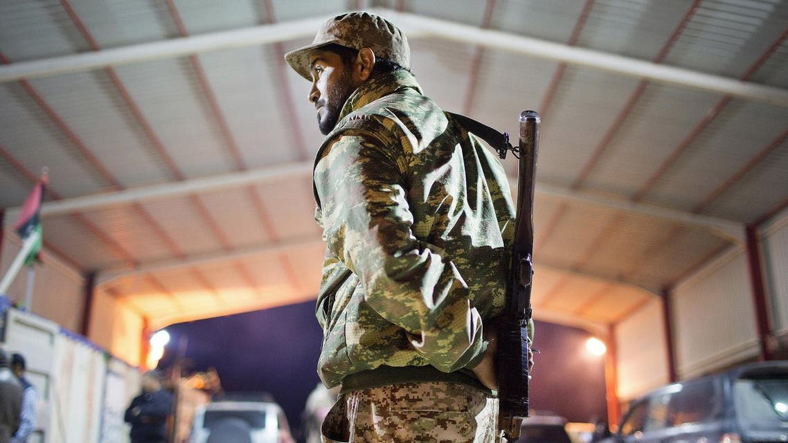 In this Wednesday, Feb. 18, 2015 file photo, a Libyan military soldier stands guard at the entrance of a town, 110 kilometers (68 miles) from Sirte, Libya. From east and west, the forces of Libya's rival powers are each moving on the city of Sirte, vowing to free it from the hold of the Islamic State group. The danger is they could very well fight each other as well. Rather than becoming a unifying cause as the United States and Europe have hoped, the fight against the jihadi group threatens to cause greater fragmentation in Libya, which has been torn apart among rival militias, tribes, governments and parliaments since the 2011 downfall of longtime autocratic ruler Moammar Gadhafi in a NATO-backed rebellion. (AP)
