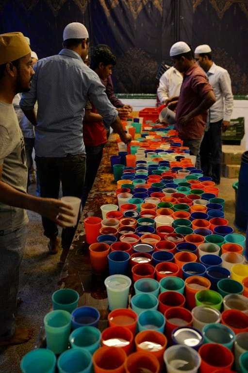 Muslims worldwide gather for Iftar and prayer