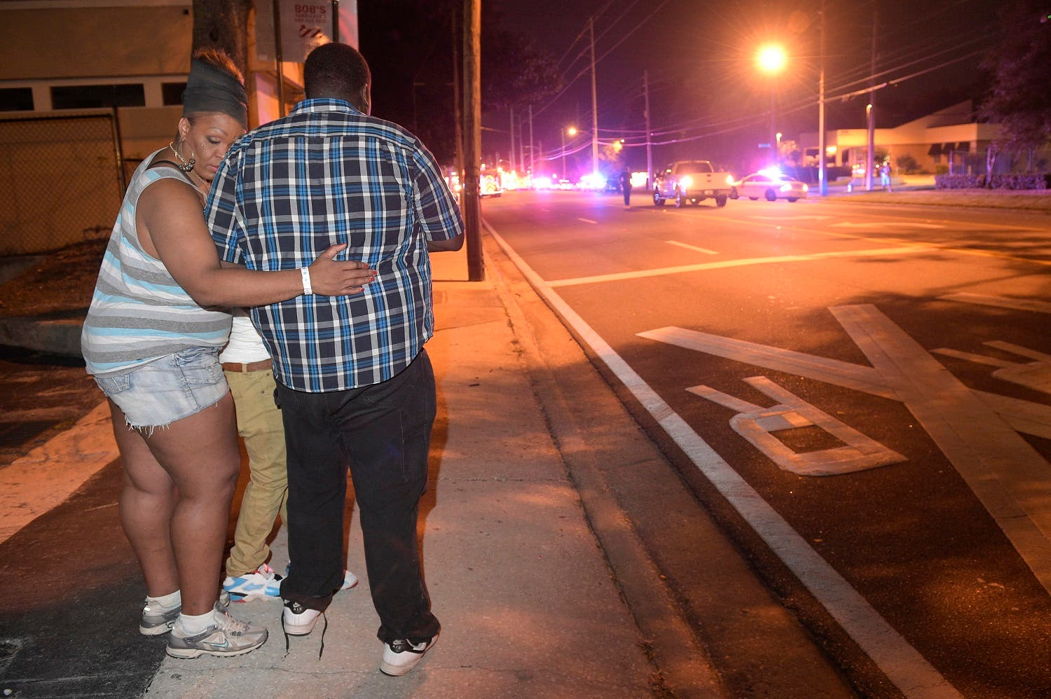 Friends and family members embrace outside the Orlando Police Headquarters during the investigation of a shooting at the Pulse night club (Photo: AP)