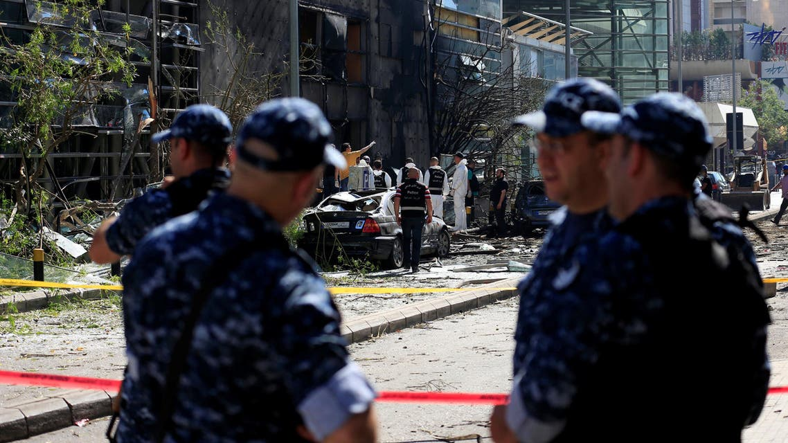 Policemen secure the area as forensic inspectors examine the site of an explosion outside the headquarters of the Lebanese Blom Bank in Beirut, Lebanon June 13, 2016. reuters