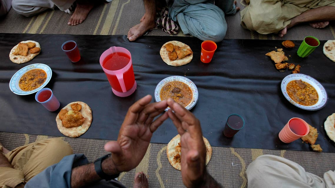 A Muslim prays before breaking his fast during the Islamic month of Ramadan at a mosque in Peshawar, Pakistan, Wednesday, June 8, 2016. Muslims across the world are observing the holy fasting month of Ramadan, when they refrain from eating, drinking and smoking from dawn to dusk. (AP Photo/Mohammad Sajjad)
