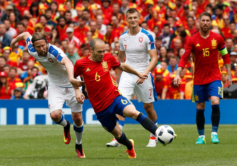 Spain's Andres Iniesta in action with Czech Republic's Jaroslav Plasil REUTERS