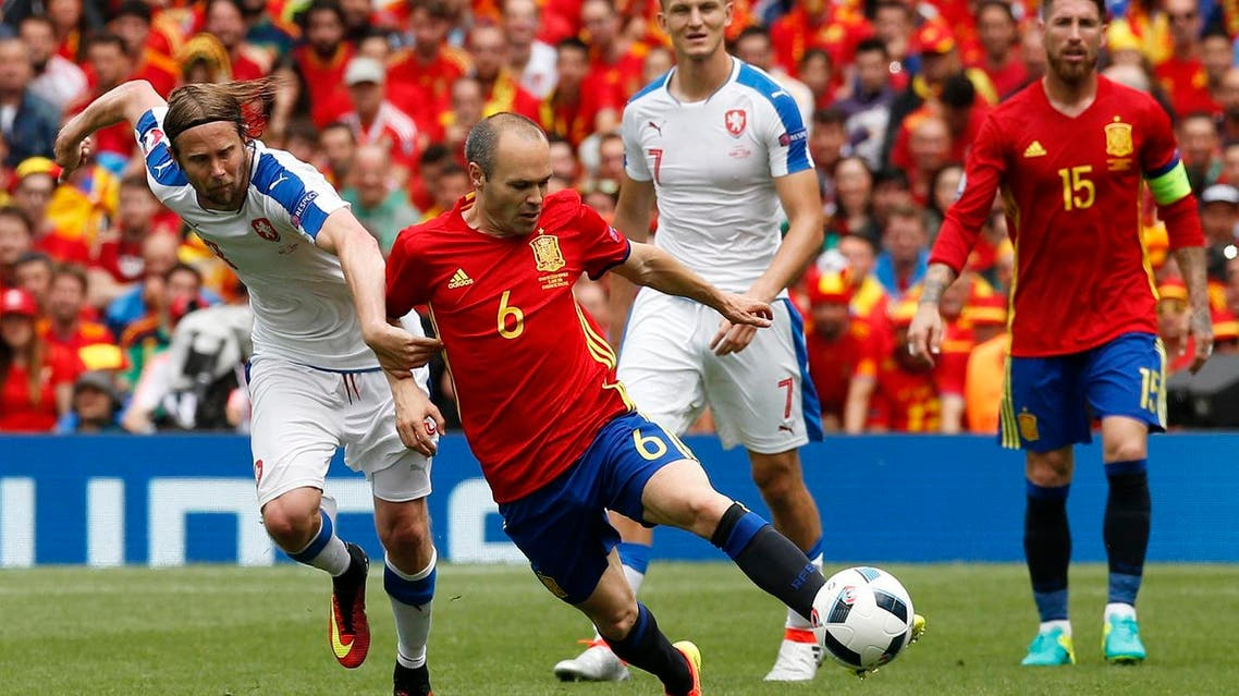 Spain's Andres Iniesta in action with Czech Republic's Jaroslav Plasil REUTERS