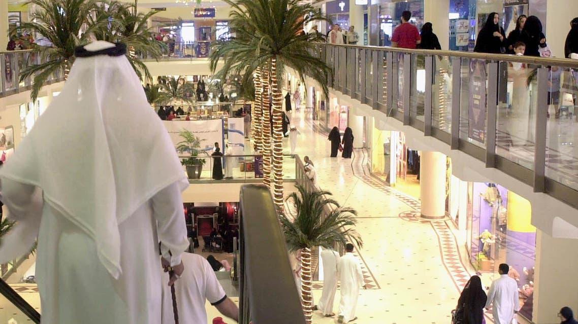 People are seen at the Faisaliya Center shopping mall in Riyadh, Saudi Arabia Oct. 31, 2003. (AP)