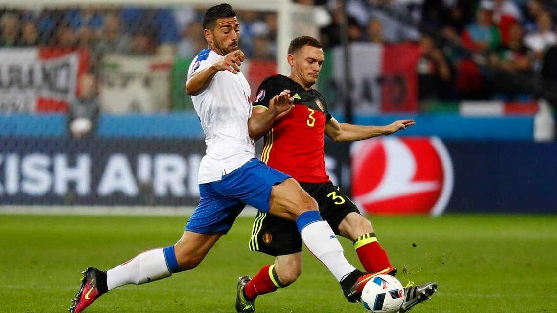 Belgium's Thomas Vermaelen in action with Italy's Graziano Pelle REUTERs