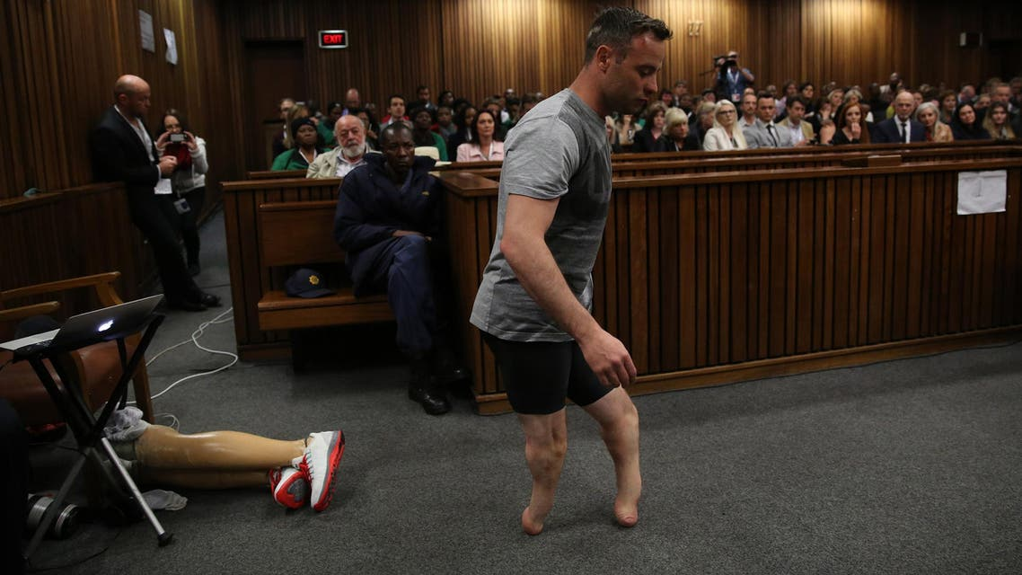 Oscar Pistorius' prosthetics lay on the floor as he walks on his stumps during argument in mitigation of sentence by his defense attorney Barry Roux in the High Court in Pretoria, South Africa, Wednesday, June 15, 2016. (AP)